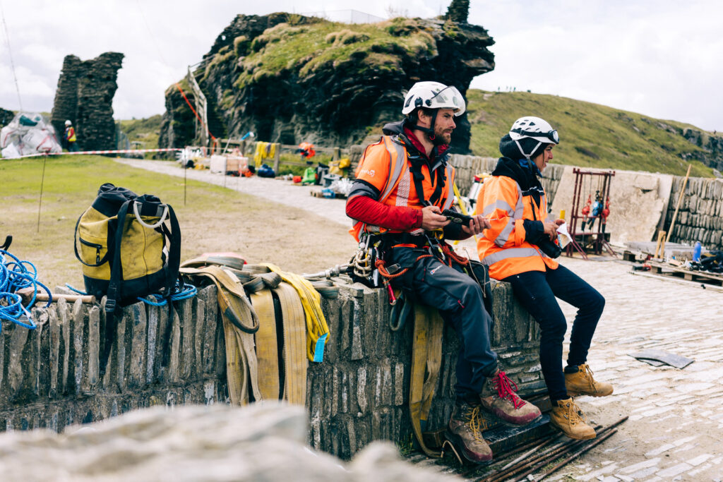 Rope access workers at the Tintagel bridge site having a break